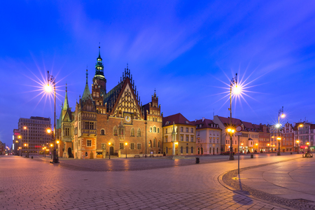 Gothic town hall and colorful houses on Market Square during morning blue hour in the Old Town of Wroclaw, Poland