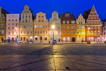 Colorful tenements on Market Square during morning blue hour in the Old Town of Wroclaw, Poland Stock Photo