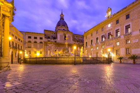 The Praetorian Fountain with church of Santa Caterina in the background on Piazza Pretoria, also known as square of Shame, Palermo at night, Sicily, Italy Stock Photo