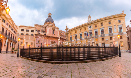 The Praetorian Fountain with church of Santa Caterina in the background on Piazza Pretoria, also known as square of Shame, Palermo in the morning, Sicily, Italy Stock Photo