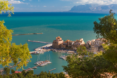 Beautiful aerial view of medieval fortress in Cala Marina, harbor in coastal city Castellammare del Golfo in the morning, Sicily, Italy