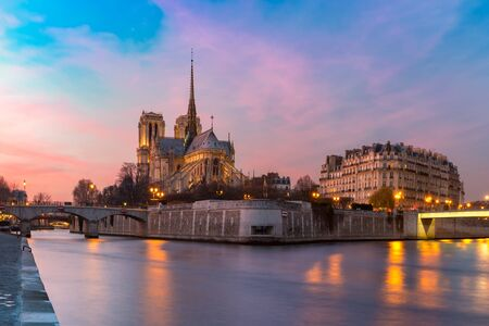 Picturesque sunset over Cathedral of Notre Dame de Paris, destroyed in a fire in 2019, Paris, France Stock Photo