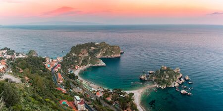 Panoramic view of Isola Bella Bay, The Pearl of the Ionian Sea, at sunset, Taormina, Sicily