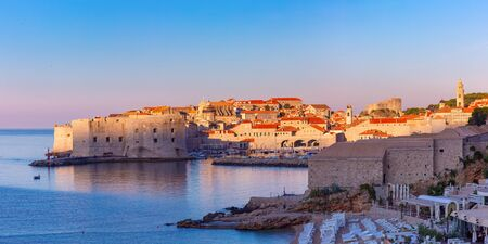 Panoramic view of Old Town with Old Harbour and Fort St Ivana at sunset in Dubrovnik, Croatia