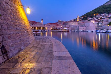 Old Harbour and Old Town of Dubrovnik durring morning blue hour, Croatia