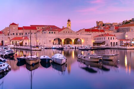 Old Harbour and Old Town of Dubrovnik at sunset, Croatia 写真素材 - 134805726