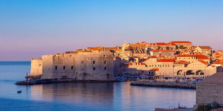 Panoramic view of Old Town with Old Harbour and Fort St Ivana at sunset in Dubrovnik, Croatia 写真素材 - 134805727