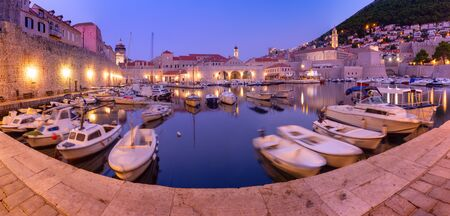 Panoramic view of The Old Harbour and Old Town of Dubrovnik durring morning blue hour, Croatia