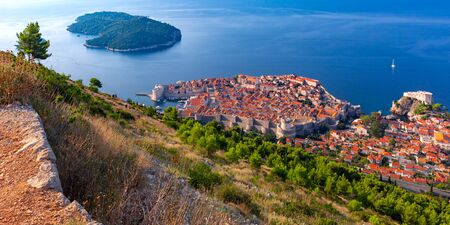 Aerial panoramic view of Lokrum island and Old Town of Dubrovnik with City wall, towers, forts and Old Harbour in Dubrovnik, Croatia 스톡 콘텐츠