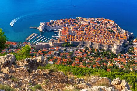 Aerial view of The Old Town of Dubrovnik with City wall, towers, forts and Old Harbour in Dubrovnik, Croatia 스톡 콘텐츠
