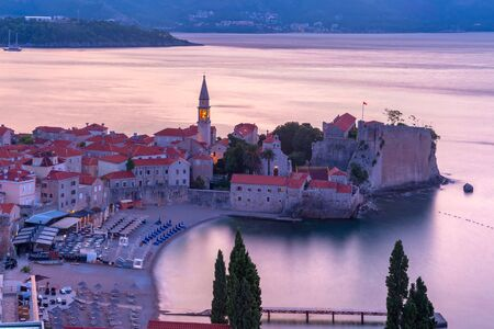 Aerial view over Old Town of Montenegrin town Budva on the Adriatic Sea at pink sunrise, Montenegro 写真素材 - 134805834