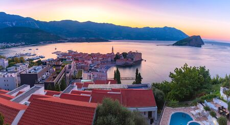 Panoramic view over Old Town of Montenegrin town Budva on the Adriatic Sea at sunrise, Montenegro 写真素材 - 134805857