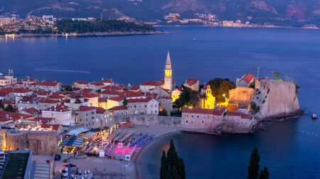Panoramic night view of The Old Town of Montenegrin town Budva on the Adriatic Sea, Montenegro
