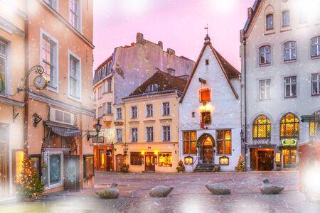 Decorated and illuminated Christmas street in Old Town of Tallinn at sunrise, Estonia
