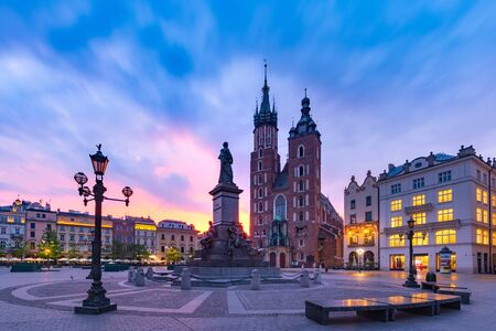 Medieval Main market square with Basilica of Saint Mary at gorgeous sunrise in Old Town of Krakow, Poland