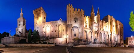 Panorama of palace of the Popes, once fortress and palace, one of largest and important medieval Gothic buildings in Europe, at night, Avignon, France Stock Photo