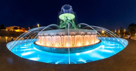 Sizable landmark Triton Fountain, featuring multiple bronze tritons in Old Town of Valletta, Capital city of Malta