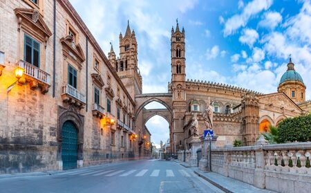 Palermo cathedral, connected with arcades to the Archbishops Palace in Palermo in the morning, Sicily, Italy
