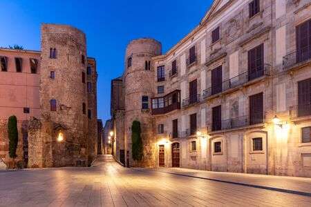 Ancient Roman Gate and Placa Nova at night, Barri Gothic Quarter in Barcelona, Catalonia, Spain