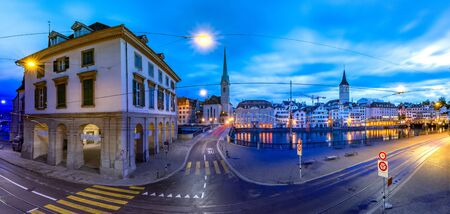 Famous Fraumunster and Church of St Peter and river Limmat Embankment during morning blue hour in Old Town of Zurich, the largest city in Switzerland Standard-Bild