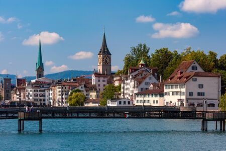 Famous Fraumunster and Church of St Peter and river Limmat Old Town of Zurich, the largest city in Switzerland