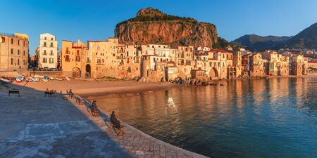 Beautiful panoramic view of coastal city Cefalu at sunset, Sicily, Italy