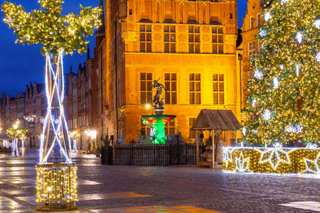 Christmas Long Market Street with Fountain of Neptune at night in Old Town of Gdansk, Poland