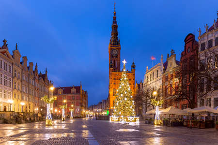 Christmas tree and illumination on Long Market Street and Town Hall at night in Old Town of Gdansk, Poland
