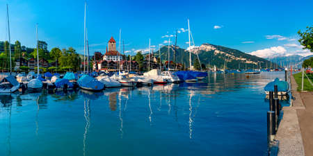 Spiez Church and Castle on the shore of Lake Thun with yachts in the Swiss canton of Bern, Spiez, Switzerland.