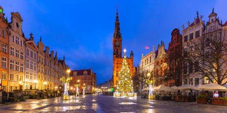 Panorama of Christmas tree and illumination on Long Market Street and Town Hall at night in Old Town of Gdansk, Poland