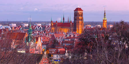 Aerial view of the Saint Mary Church and City Hall at sunset in Gdansk, Poland