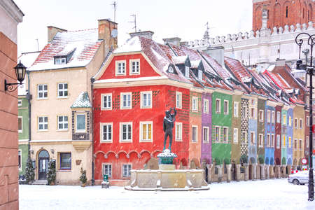 Merchants houses and fountain at Old Market Square in Old Town in the snowy winter day, Poznan, Poland