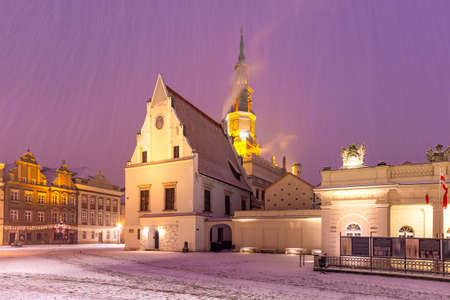 Poznan Town Hall on Old Market Square in Old Town in the snowy Christmas night, Poznan, Poland