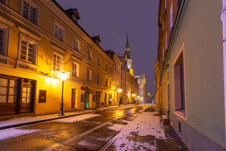 Empty street and Poznan Town Hall in Old Town at night, Poznan, Poland