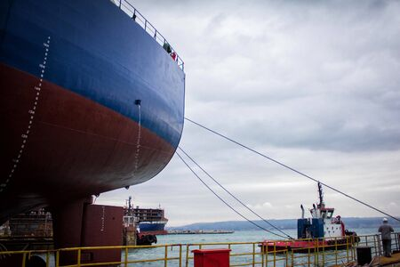 launching of renovated tanker cargo ship from dock to water