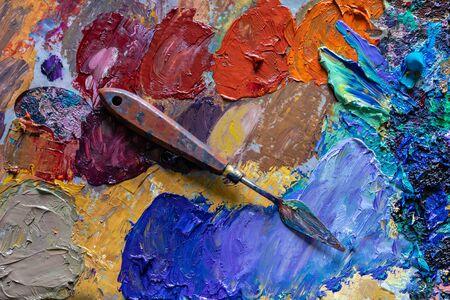 different color dried oil paint. colorful acrylic paint. modern art concept. painter palette knife.