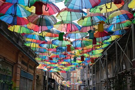 Background colorful rainbow different color umbrellas. unban tourist street decoration. Istanbul, Karakoy