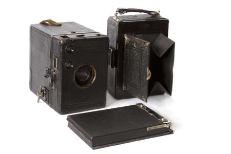 old black photo camera and photoaccessories isolated on white Stock Photo - 13616296