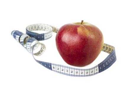 red apple and measure tape isolated on white