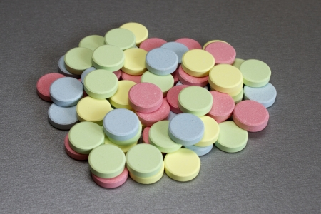 multi-colored medical tablets on  gray background