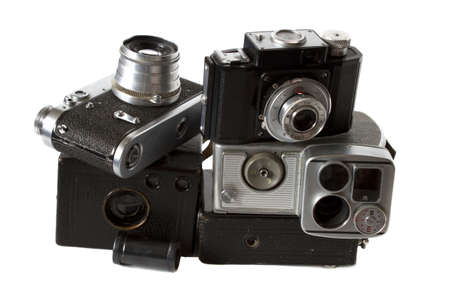 old black photocamera, videocamera and photoaccessories isolated on white