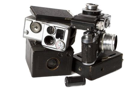 old black photocamera, videocamera and photoaccessories isolated on white Stock Photo - 13733401