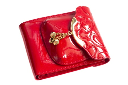 Red glossy leather purse with gold metal  isolated on white