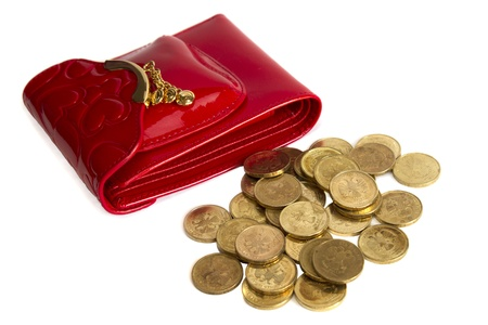 Red glossy leather purse with gold metal  and  gold coins isolated on white photo