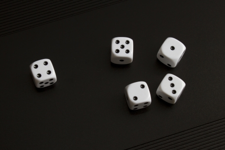 white dice on black background  photo