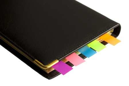 Black notepad with multi-colored bookmarks  isolated on white background Stock Photo - 13764791