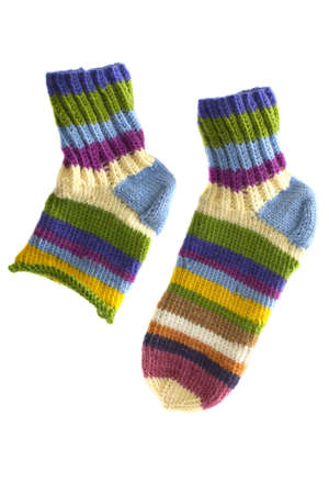Two multi-colored knitted socks isolated on white