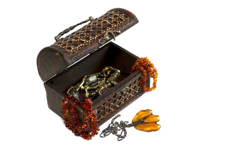 wooden casket and jewellery from amber isolated on white Stock Photo