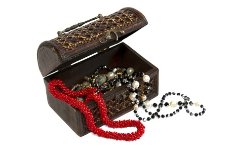 Wooden casket and coral beads isolated on white Stock Photo
