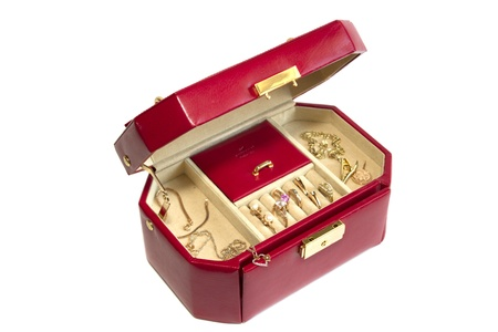 Leather box with gold jewelry isolated on white